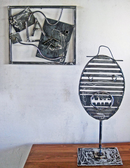 a mask and wall piece